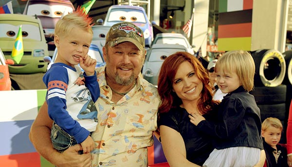 Image of Cara Whitney with her husband Larry along with their kids