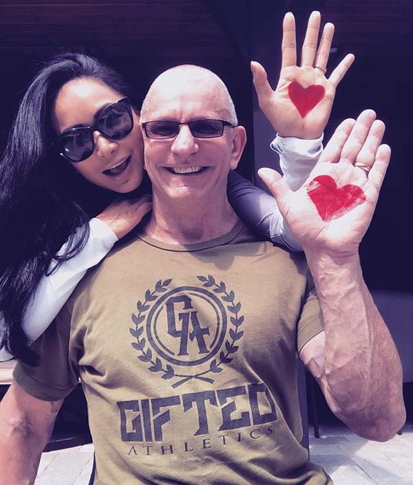 Image of Robert Irvine with his wife Gail Kim